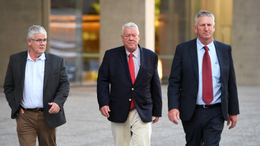 The Wagner brothers - Neil, John and Denis Wagner - outside the Brisbane Supreme Court at an earlier appearance.