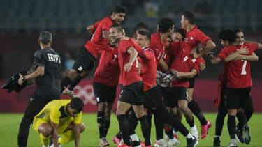 Egypt's players celebrate their 2-0 victory over Australia.