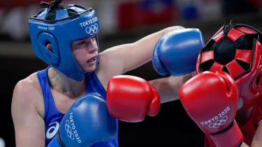 Skye Nicolson (blue) lands a blow omn Karriss Artingstall.
