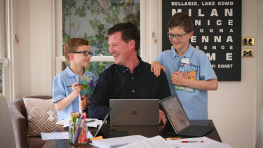 Officeworks general manager finance Justin McKernan (with sons Hamish, left, and William), has enjoyed the extra time with family while working from home.