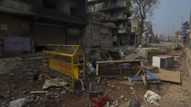 Burnt and vandalised buildings in New Delhi after clashes between Hindu and Muslim groups.
