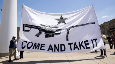 "Demonstrators hold a large banner that reads ""Come And Take It,"" during a pro-gun rally on the sidelines of the National Rifle Association annual meeting in Dallas, Texas."