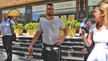 Long day: Marko Simic leaves Downing Centre in the morning.