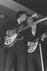 George Harrison and John Lennon perform in Melbourne in 1964.