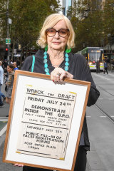 Jean McLean, convener of the Save Our Sons movement, holding a flyer promoting a rally and an event to fill-in false registration forms for National Service.