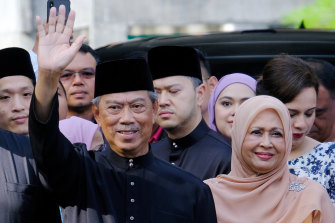 Muhyiddin Yassin, Malaysia's new prime minister waves to members of the media ahead of the swearing in ceremony on Sunday.