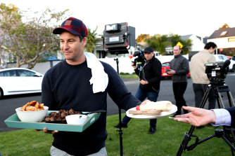 Jacinda Ardern's partner Clarke Gayford brought food to media waiting on the election result outside their home.