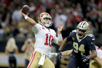 Jimmy Garoppolo throws a pass against the Saints.