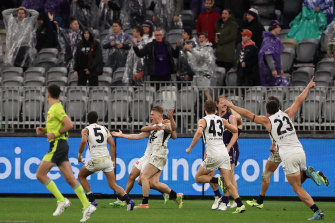 From the jaws of defeat: Jack Newnes celebrates his after-the-siren goal.