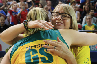 Outgoing Diamonds coach Lisa Alexander and Caitlin Thwaites embrace after Australia's 66-53 win over the Super Netball All Stars.