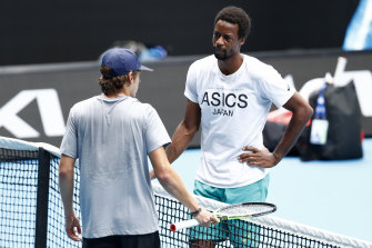 Gael Monfils and Alex de Minaur are free to mingle on the practice court on Saturday.