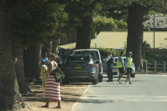 Police pull over a car on Ocean Road at Palm Beach on Saturday. The government has asked that people stay at their primary residence over the Easter long weekend due to the coronavirus.
