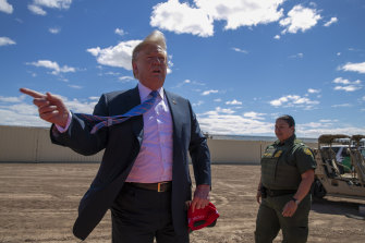 US President Donald Trump visits a section of the border wall with Mexico in Calexico, California, in April.