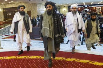 Taliban co-founder Abdul Ghani Baradar, centre, arrives with other members of the Taliban delegation for an international peace conference in Moscow in March.