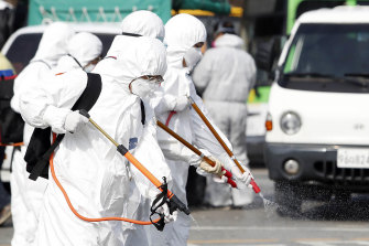 Concerted action: A bus is disinfected in South Korea.