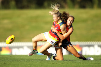 Crows star, Irish import Ailish Considine, is tackled by Giant Tarni Evans.