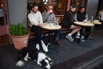 George and Peter Larsen sit down for a coffee at Gilson in South Yarra after restrictions eased overnight.