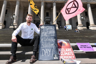 Extinction Rebellion hunger striker Dan Bleakley on the steps of Parliament in Melbourne.