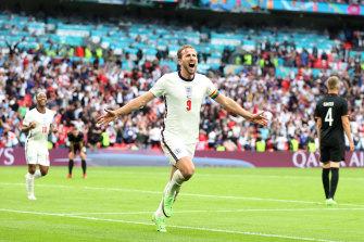 Harry Kane celebrates after scoring England's second goal.