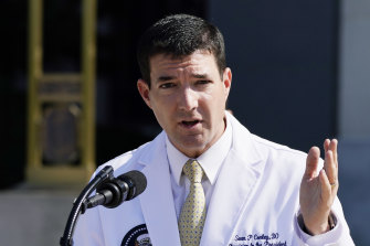 Dr Sean Conley briefs reporters outside the Walter Reed National Military Medical Centre in Bethesda on Sunday.