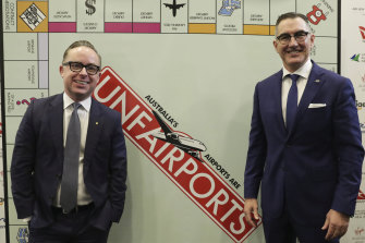 "Paul Scurrah (right) with Qantas CEO Alan Joyce at the National Press Club last year. Ratings agencies are concerned about Australia's ""duopoly-like domestic market structure""."