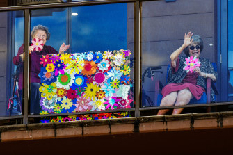 Residents of Arcare Knox receive students' floral creations.