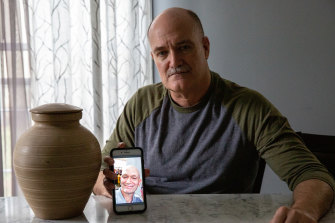 Russell Blatt shows a photo of his brother, Stacy, who donated more than he intended to former President Donald Trump's 2020 re-election campaign and later died of cancer in February of 2021.
