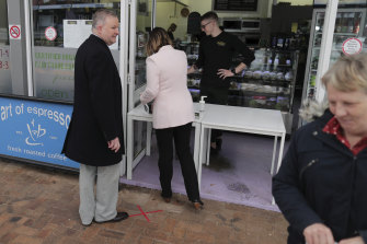 Kristy McBain steps in to pay for the coffee after Anthony Albanese left his wallet in the car.