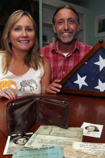 Sharon McCusker Moore and her brother Steven McCusker pose with their father's long lost wallet and its contents in Dover, New Hampshire.