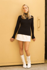 Margot Robbie as actor Sharon Tate.