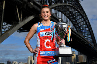 Sidelined Swift Maddy Proud will be hoping to hold the Super Netball trophy again come Sunday.