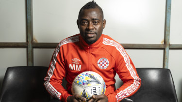 A long road, and love, have led Michael Mensah to Canberra FC.