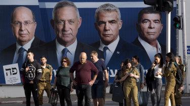 A Blue and White billboard showing, from left, Moshe Yaalon, Benny Gantz, Yair Lapid and Gabi Ashkenazi.