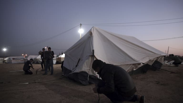 Palestinians set up tents near the Gaza Strip border with Israel on Sunday.