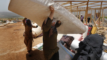 Syrian refugees being evacuated from the Deir Al-Ahmar camp in eastern Lebanon.