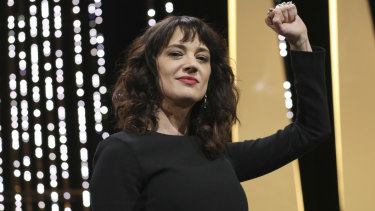 Argento gestures on stage during the closing ceremony of the Cannes Film Festival.