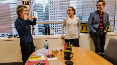 Daly (left) meets with staffers Fernanda Nechio, centre, and Neil Gerstein at her office.