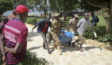 Rescue workers carry a body recovered from Lake Victoria on Sunday.