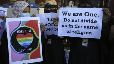 Indian Muslim women hold placards denouncing the new interfaith marriage law in Uttar Pradesh, during a protest in Bengaluru, India.