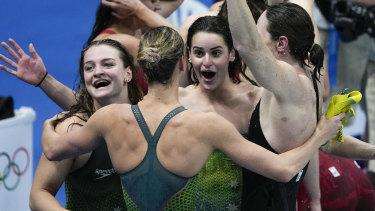 Australia celebrate gold in the 4x100m medley relay.