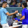 Bernard Tomic congratulates Novak Djokovic after their match in Miami.