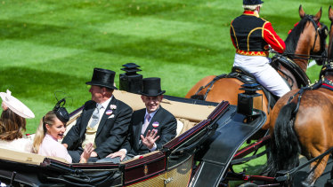 On a roll: Chris Waller and wife Stephanie give the royal wave at Ascot.