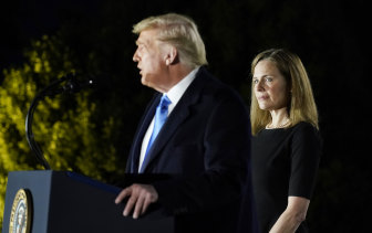 Amy Coney Barrett with Donald Trump on Monday after the Senate confirmed her appointment to the US Supreme Court.