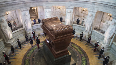 French President Emmanuel Macron and his wife, Brigitte, (top left) stand by the tomb of Napoleon Bonaparte.