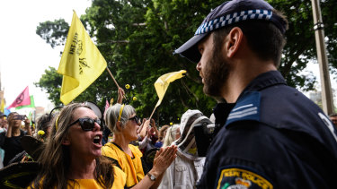 Activists from Extinction Rebellion participate in a protest in Sydney on Tuesday.