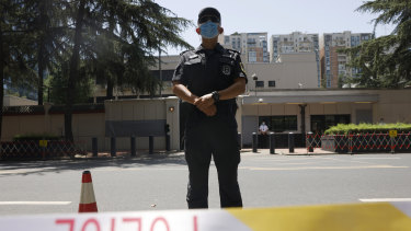 Chinese police officers guard the former United States consulate in Chengdu, formally closed in July.