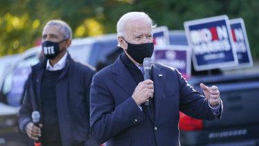 Former Vice President Joe Biden and former President Barack Obama speak in Michigan on Sunday AEDT.