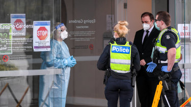 Police and workers at the Epping Gardens Aged Care Facility in Epping in Melbourne's north on Wednesday.