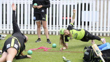The skipper for the day, 17-year-old Hannah Darlington, left, led the girls - and Keoghan - through a light warm-up.