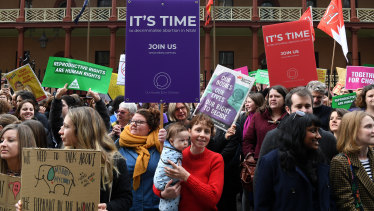 Pro-choice advocates and supporters of the Reproductive Health Care Reform Bill hold a rally outside the NSW Parliament last month.